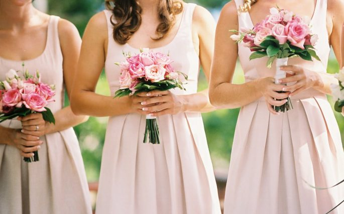 Wedding time: bridesmaids in high fashion tailored dress